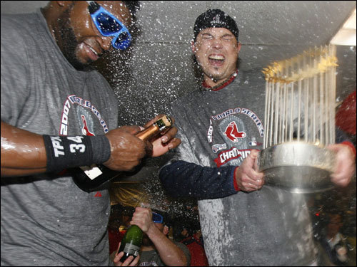 David Ortiz (left) celebrated in the clubhouse.