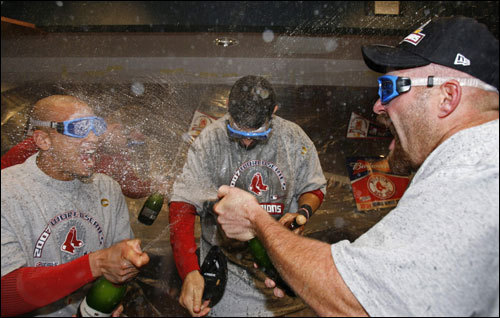 Red Sox players sprayed champagne during celebrations in the clubhouse.