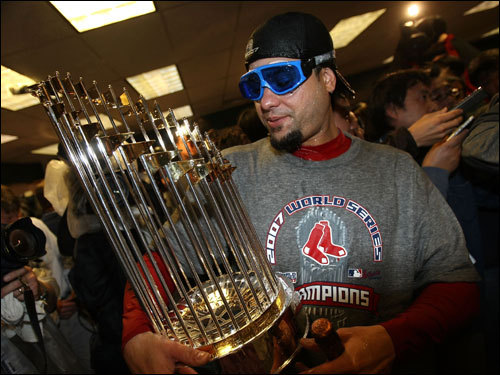 Manny Delcarmen held the World Series trophy during celebrations.