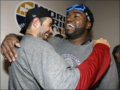 Mike Lowell and David Ortiz hugged during celebrations.