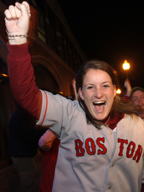 A Red Sox fan celebrates near Fenway Park.