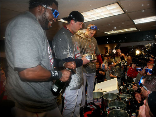 David Ortiz (left) and Josh Beckett (center) celebrated with teammates in the clubhouse.