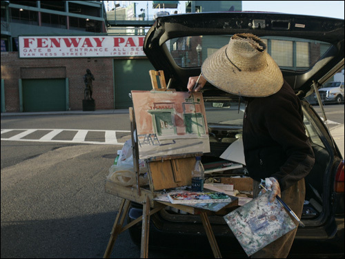 Anne McGhee, who has a studio in Boston, worked on a watercolor of Fenway Park.