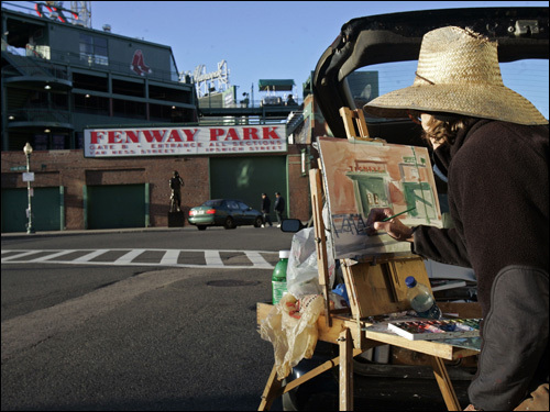 Earlier in the day, Anne McGhee painted outside a quiet Fenway Park.