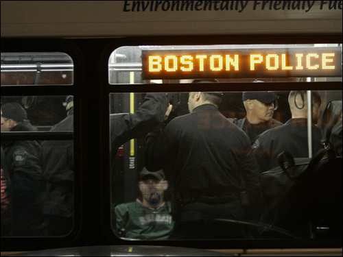Outside Boston police headquarters, officers were transported by MBTA buses and deployed throughout the city before the start of Game 4.