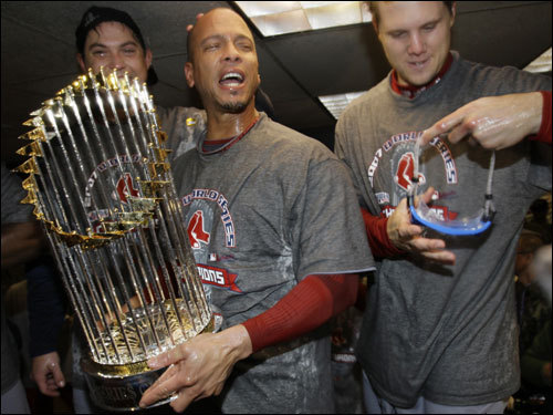 Royce Clayton had his turn holding the World Series trophy.