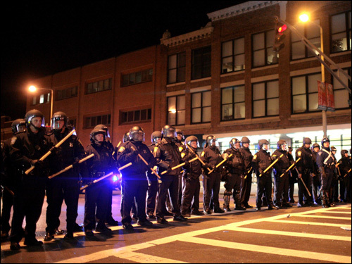 Boston police in riot gear stood guard on Boylston Street near Fenway Park.