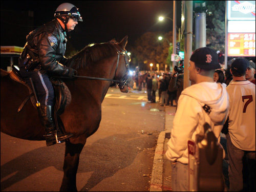 A mounted patrol officer tried to manage the crowd near Fenway Park.