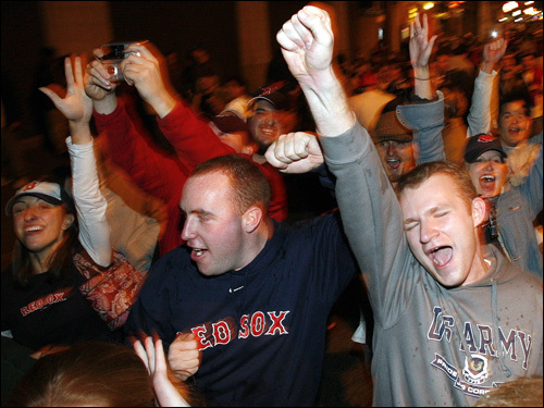 Fans celebrated in the streets near Fenway Park.
