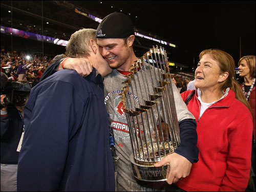 Starting pitcher Jon Lester of celebrated with his parents after winning Game 4 by a score of 4-3.