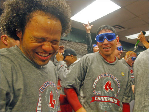 Coco Crisp (left) and Jacoby Ellsbury (right) celebrated in the clubhouse.