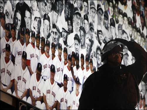 A police officer in riot gear surveyed the crowd in front of a billboard outside Fenway Park.