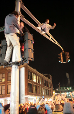 Fans celebrated by climbing street lights on Boylston Street near Fenway Park ...