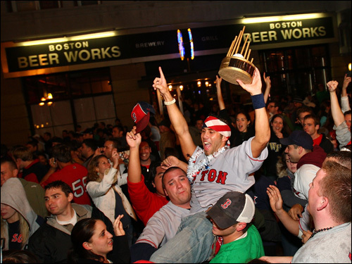 Fans celebrate on Brookline Ave.