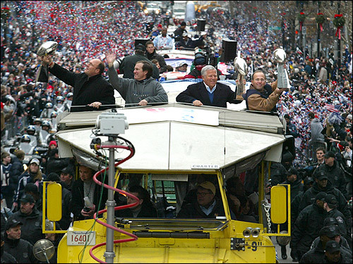 February 8, 2005: New England Patriots top brass (Vice President of Player Personnel Scott Pioli, Head Coach Bill Belichick and Chairman and Owner Robert Kraft and Vice Chairman Jonathan Kraft) with their 3 Vince Lombardi Trophies during the Patriots Super Bowl parade through downtown Boston.