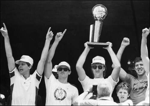 June 10, 1986: Celtics team members Danny Ainge, Rick Carlisle, Larry Bird and Bill Walton celebrated with fans during a rally.