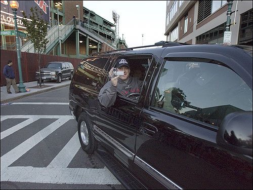 Red Sox pitcher Curt Schilling turned cameraman when he returned to Yawkey Way.