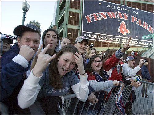 Fans on Yawkey Way cheered on the returning Red Sox.