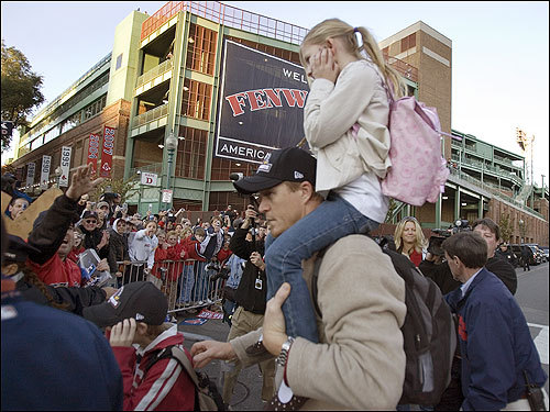 Red Sox pitcher Mike Timlin carried his daughter on his shoulders as he waded through the crowd at Yawkey Way.