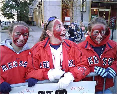 Stephanie Chaves, Michell Zullo, and Jessica Chaves, all of Everett, painted their faces in honor of David Ortiz.