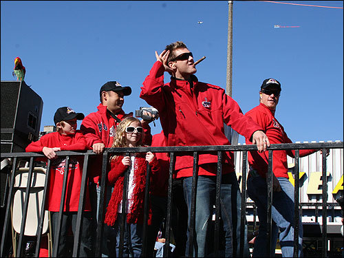 Papelbon, with fellow reliever Mike Timlin (back right), listened to the sounds of victory on the parade route.