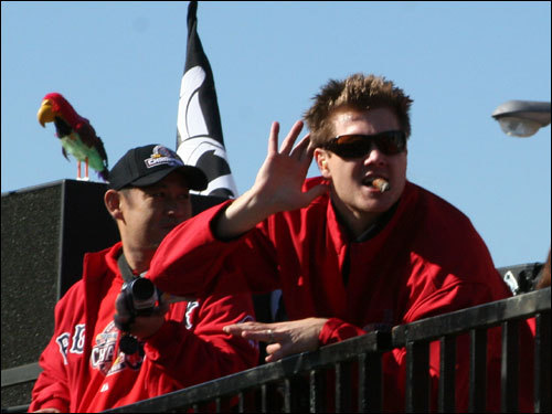 Papelbon reacted to the cheering crowd while the Red Sox bullpen parrot was perched above the duck boat.