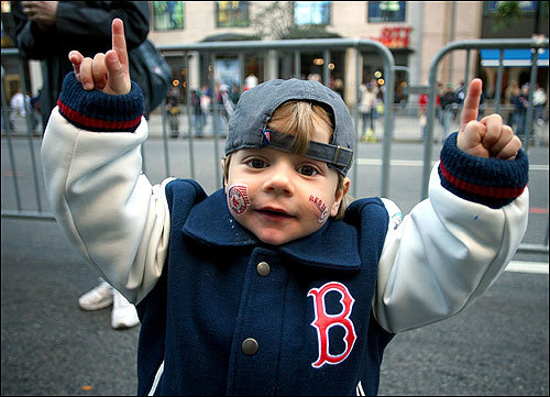 Marco Carrillo, 2, of Everett did his best Big Papi imitation.