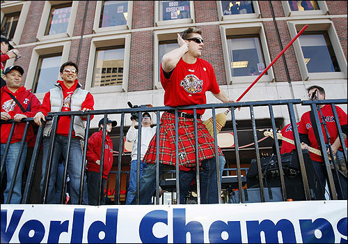 As the float neared City Hall, Papelbon, wearing the kilt and brandishing his broom/air guitar, encouraged the crowd to get louder.