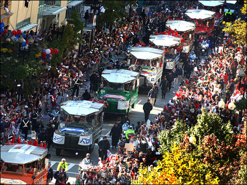 The Boston Red Sox celebrate winning the 2007 World Series with their fans with a parade in Duck Tour boats.
