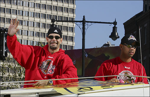Mike Lowell (left) and Alex Cora on a duck boat during the parade.