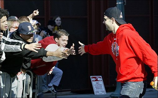 Mike Lowell greets fans outside Fenway Park.