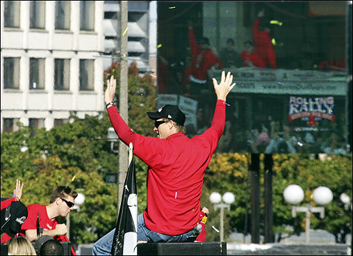 Mike Timlin waves to the crowd with giant video screen in the background at City Hall Plaza.