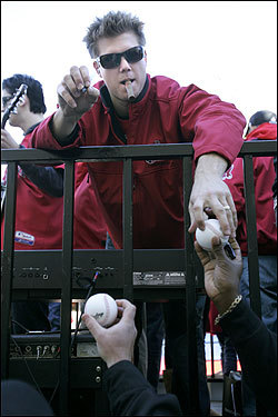 Jonathan Papelbon signs baseballs for Boston Police outside Fenway Park.