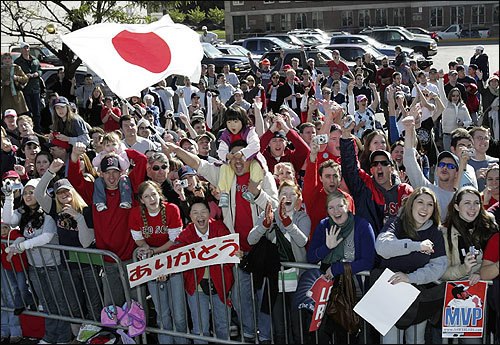 Along Boylston Street, fans wave the Japanese flag for pitchers Daisuke Matsuzaka and Hideki Okajima.