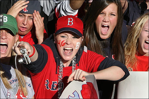 A Jacoby Ellsbury fan surrounded by screaming fans on Boylston Street.