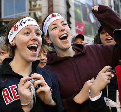 Karyn Sporer and Lisa Speropolous, of Southboro, wear Dice-K headbands while craning to see the coming parade.
