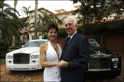 Bill Lilly with Valerie Kaan at their Boca Raton, Fla/, home in better times. In the background are their Rolls Royces.