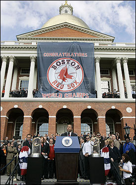 Governor Deval Patrick spoke at the celebration as a banner commemorating the Red Sox hung from the State House.