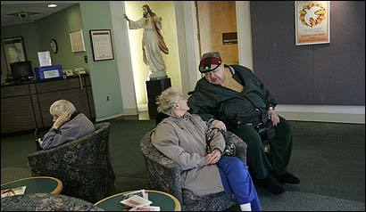 Longtime patient Francis Feeley, 77, talked with Helen Wilcox as he waited for a ride in the Caritas Carney Hospital lobby.