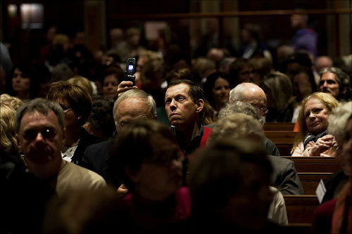 John Cuozzo of Wakefield snapped a picture of Archbishop Desmond Tutu with his cellphone. Tutu offered greetings and prayer at the Old South Church in Boston for the Friends of Sabeel conference on Palestinian rights.