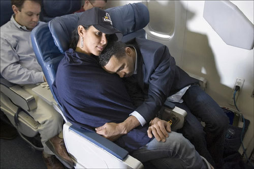 Red Sox shortstop Julio Lugo slept in the arms of his wife Sulky during the flight home from Denver after winning the World Series.