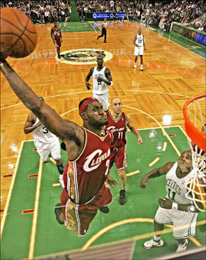 LeBron James of the Cleveland Cavaliers slam dunked against the Boston Celtics during the second quarter of an exhibition game.