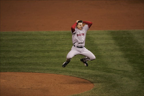 Jonathan Papelbon reacted after the last out of the ninth inning by leaping into the air and running toward catcher Jason Varitek (not pictured). The Red Sox swept the Colorado Rockies in four consecutive games.