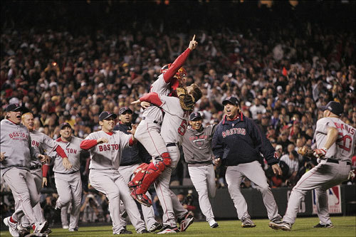 Red Sox teammates rushed the pitcher's mound following the last out of Game 4 of the World Series.