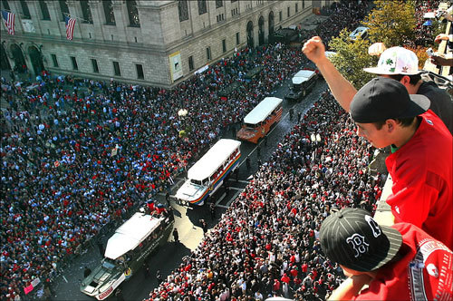 Sox fans cheered from the rooftop of an office building as the rolling Red Sox rally passed on Boylston Street below them.