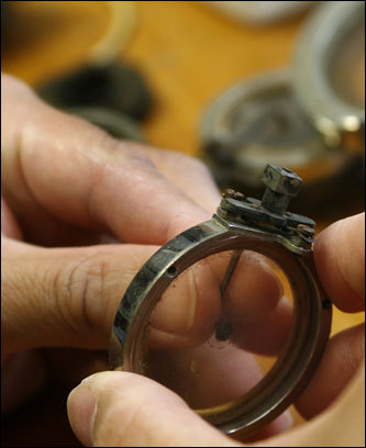 Here, Peng is seen working on a part from an old phonograph. 'It is something I love, and something I'd like to be doing for a long time,' said Peng, who is trained as a piano tuner - he also teaches piano - and self-taught as a phonograph repairman. 'There's no school for this,' he said. The price for repairs varies according to the job and the parts needed, Peng said. Replacing a spring for the motor costs $55, repairing a sound box $50.