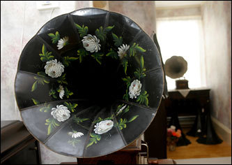 A Victor phonograph, circa 1902, has a floral pattern decoration around its horn. 'Different phonographs were made differently and all sound different,' Peng explained.