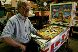 Greg Nichols repairs vintage pinball machines. Nichols's shop - there's no sign, but it's called Gregg Music & Vending - sits in the back of a warehouse on Water Street in Beverly.