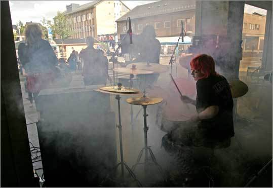 The band Burka Brothers performs during a street fair.