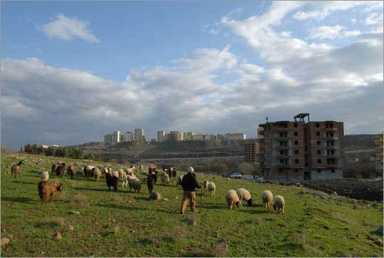 Thanks to irrigation projects, the outskirts of Sanliurfa, 40 miles north of Syria, have seen a construction boom in the last several years. Balconied apartment towers appear in areas once mostly used for farming.